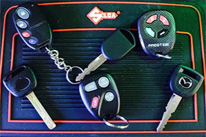 Photo of a variety of car keys, fobs, remotes and transponder keys